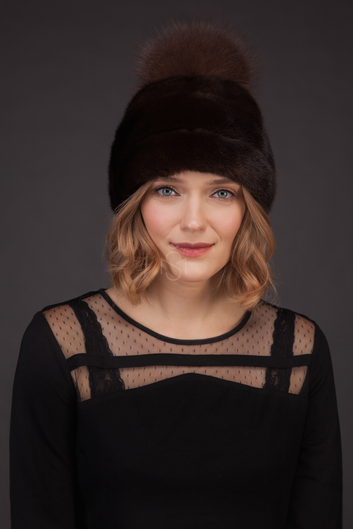 Mink fur hat with pom-pom natural brown made by SILTA MADA fur studio in Vilnius