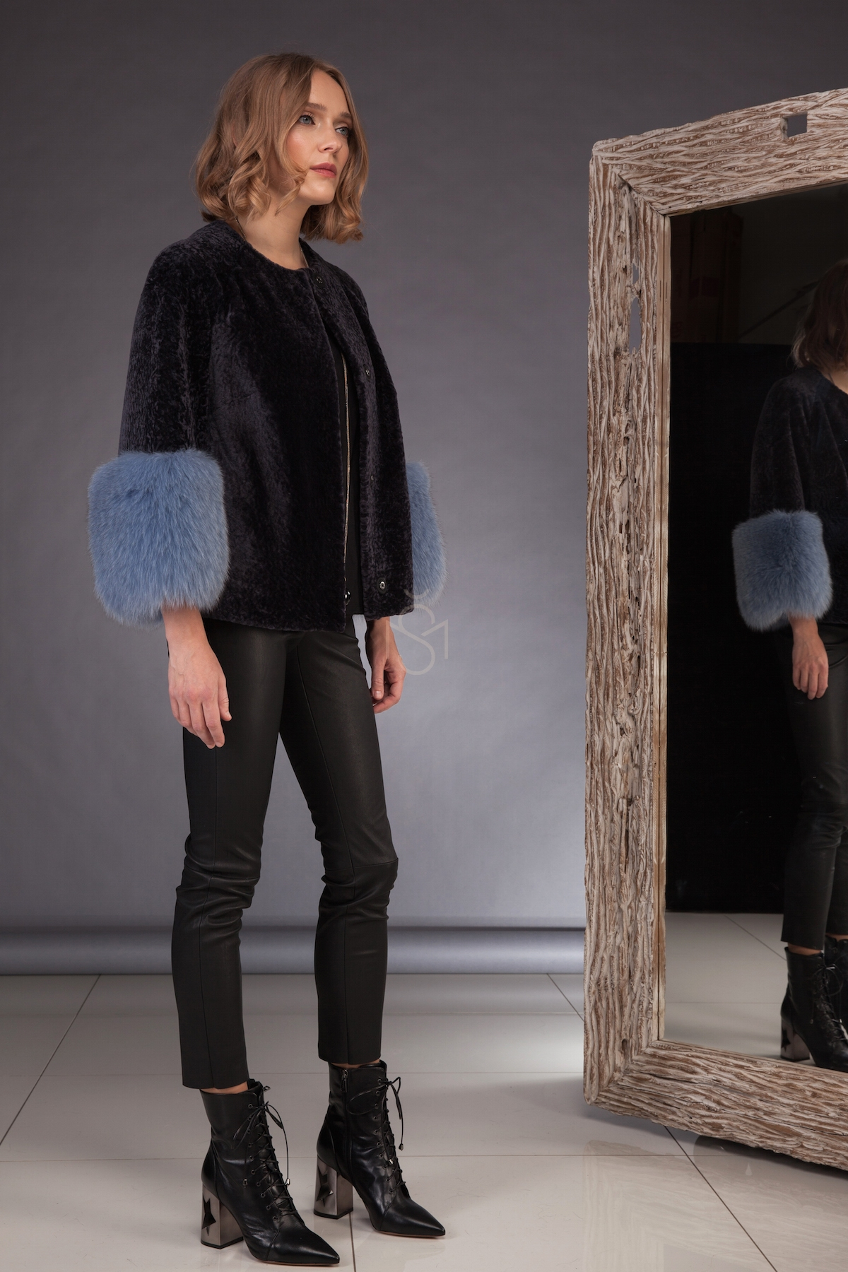 Sheepskin coat with fox fur sleeves made by SILTA MADA fur studio in Vilnius