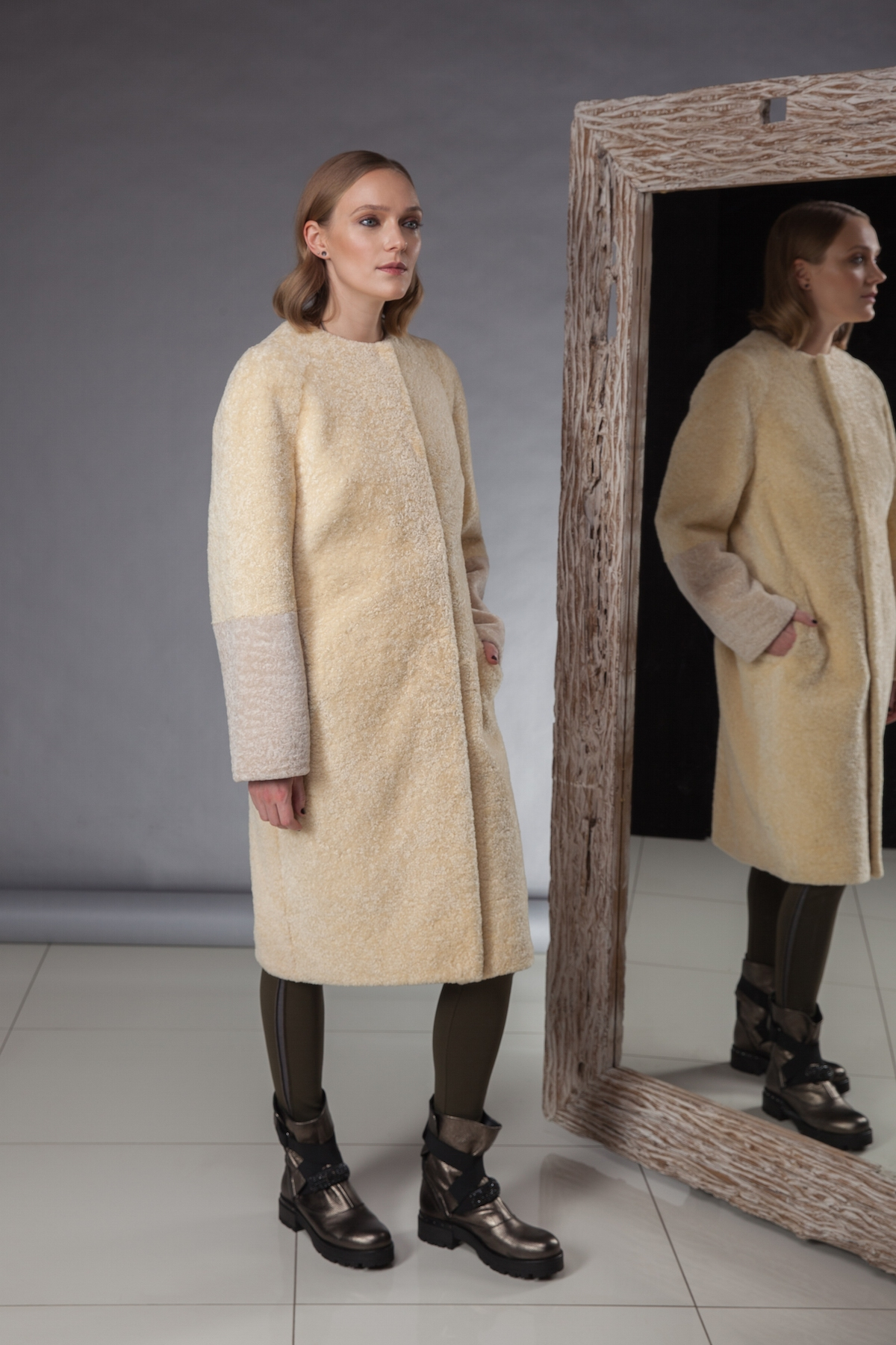 especially soft and light sheepskin coat decorated with fox fur made by Silta Mada fur studio in Vilnius.