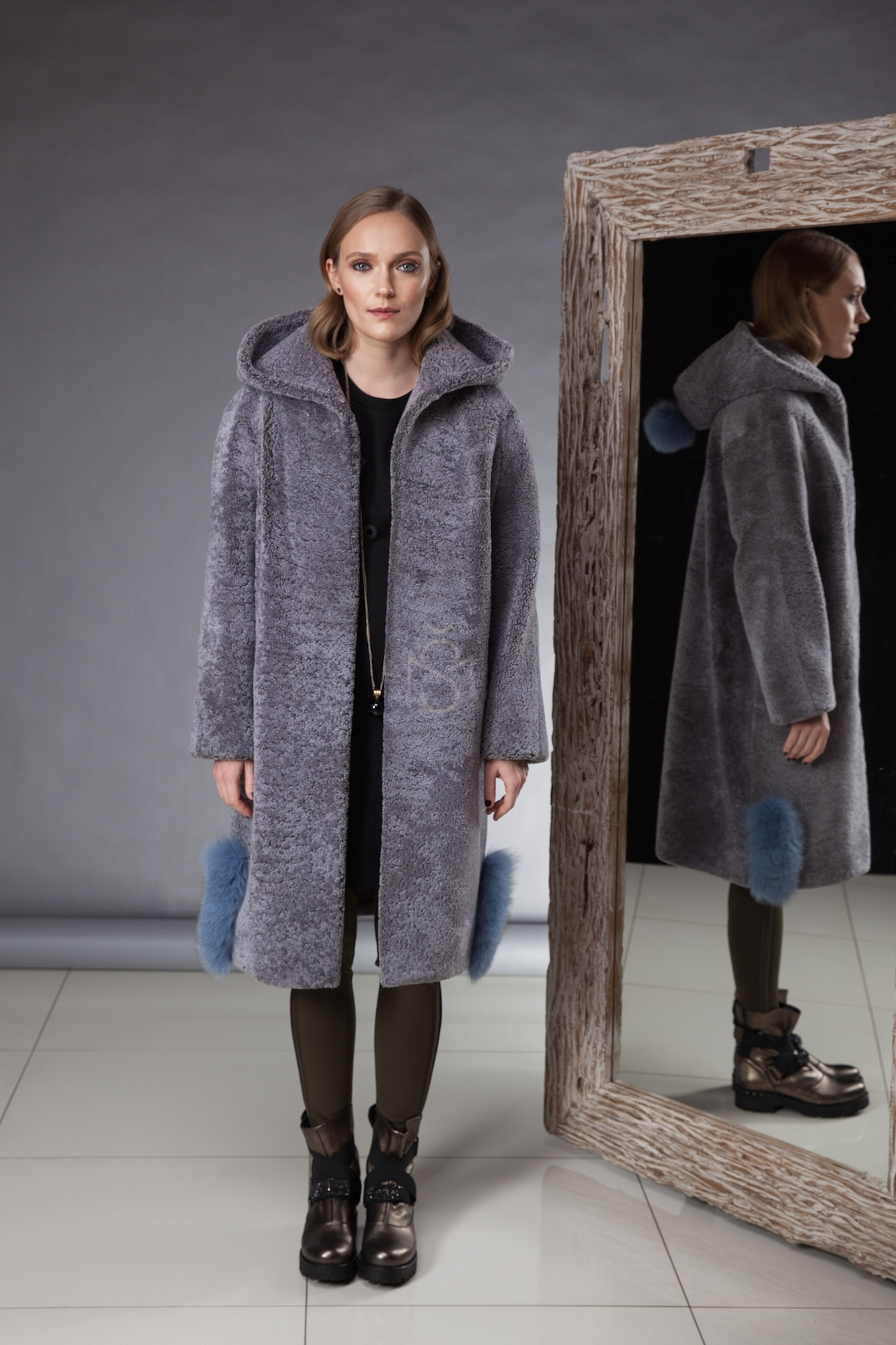 Exceptionally soft and light sheepskin coat with hood made by Silta Mada fur studio in Vilnius