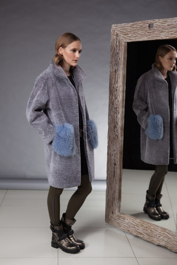 especially soft and light sheepskin coat decorated with fox fur made by Silta Mada fur studio in Vilnius